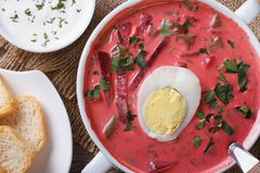 Fresh beet soup with egg close up. horizontal top view Royalty Free Stock Photography