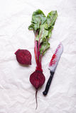 Fresh beetroot in half with knife, isolated on a paper background Royalty Free Stock Photography