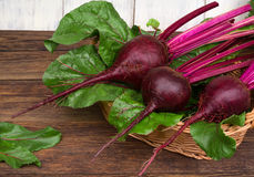 Fresh beetroot with leaves on wooden table Royalty Free Stock Photos