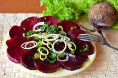 Fresh beetroot salad with chopped onion on the white plate Stock Photography
