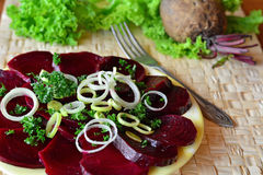 Fresh beetroot salad with chopped onion on the white plate Stock Image