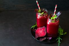 Fresh beetroot smoothie, beet, arugula and lettuce leaves stock photography