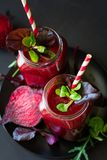 Fresh beetroot smoothie, beet, arugula and lettuce leaves royalty free stock photography