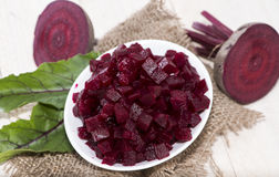 Fresh Beetroot on wooden background. Some fresh Beetroot on wooden background Royalty Free Stock Photo