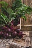 Fresh beetroots on rustic table. Fresh homegrown beetroots on wooden rustic table, harvest time, organic farm Stock Photos