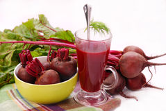 Fresh beets with leaves and clear soup royalty free stock image