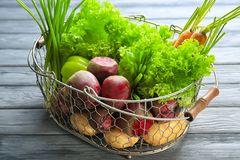 Fresh beets with vegetables in metal basket Stock Images