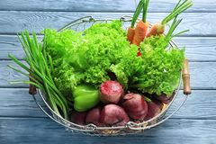 Fresh beets with vegetables in metal basket Stock Photo