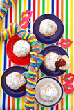 Fresh beignets on colorful plates Stock Image