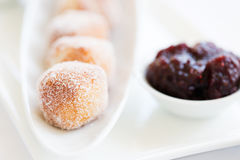 Fresh beignets with sauce Stock Image