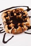 Fresh  Belgian waffle with chocolate. Freshly baked Belgian waffle with chocolate syrup Royalty Free Stock Photo