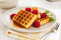 Fresh belgian waffles with syrup and raspberries Stock Image