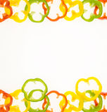 Fresh bell pepper rings, on white with copy-space Royalty Free Stock Image