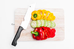 Fresh bell pepper Yellow and red sliced on wooden board Stock Images