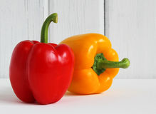 Fresh bell peppers against white wood background Royalty Free Stock Photo
