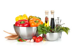 Fresh bell peppers and herbs in bowls Royalty Free Stock Photos