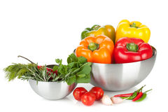 Fresh bell peppers and herbs in bowls Royalty Free Stock Images