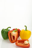 Fresh bell peppers, one cut in half Royalty Free Stock Image
