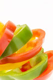 Fresh bell peppers sliced into colorful rings closeup Royalty Free Stock Images