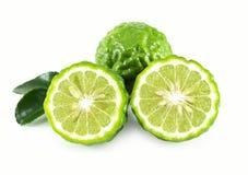Fresh bergamot fruit slice with green leaf isolated on white background, herb and medical. Fresh bergamot fruit slice with green leaf isolated on white stock image