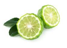 Fresh bergamot fruit slice with green leaf isolated on white background, herb and medical. Fresh bergamot fruit slice with green leaf isolated on white royalty free stock images