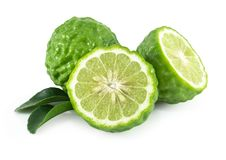 Fresh bergamot fruit slice with green leaf isolated on white background, herb and medical. Fresh bergamot fruit slice with green leaf isolated on white royalty free stock photos