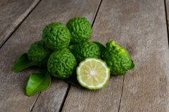 Fresh bergamot fruit on wooden table. Background royalty free stock images