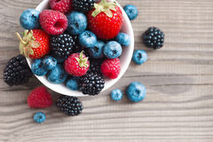 Fresh berries in a basket on rustic wooden background. Close up, top view, high resolution product. Harvest Concept Royalty Free Stock Photography