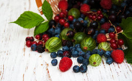 Fresh berries with basket. On a wooden background Royalty Free Stock Photography