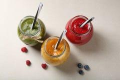 Fresh berries beverage in jars Royalty Free Stock Photos