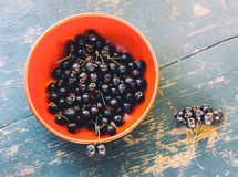 Fresh Berries Of Black Hawthorn In The Black Bowl On The Old Wooden Table Closeup Stock Photo