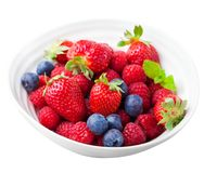 Fresh berries, blueberry, strawberry, raspberry. In a white ceramic bowl. Isolated on white Royalty Free Stock Photography