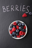 Fresh berries in a bowl on slate Stock Image