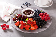 Fresh berries with chocolate sauce for breakfast Royalty Free Stock Images