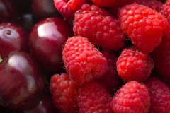 Fresh berries, close-up. Fresh berries of raspberry and cherry royalty free stock photos