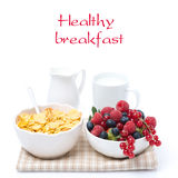 Fresh berries, corn flakes and milk, isolated Stock Photo