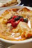 Fresh Berries on Crepes with Syrup Royalty Free Stock Image