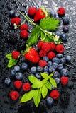 Fresh Berries on Dark  Background. Fresh Berries on Dark Background. Strawberries, Raspberries and  Blueberries.  Health, Diet, Gardening, Harvest Concept Stock Image