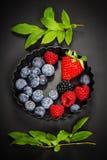 Fresh Berries on Dark  Background. Fresh Berries on Dark Background. Strawberries, Raspberries and  Blueberries.  Health, Diet, Gardening, Harvest Concept Stock Images