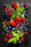 Fresh Berries on Dark  Background. Fresh Berries on Dark Background. Strawberries, Raspberries and  Blueberries.  Health, Diet, Gardening, Harvest Concept Royalty Free Stock Images