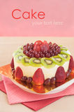 Fresh berries fruit cake with whipped cream. Stock Images