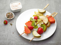 Fresh berries and fruit pieces on skewers Stock Image