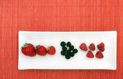 Fresh berries, fruits - nouvelle cuisine style. Nicely presented on bamboo table-mat Stock Photo