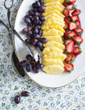 Fresh berries and fruits on plate Royalty Free Stock Photography