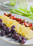Fresh berries and fruits on plate. Royalty Free Stock Images