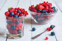 Fresh berries in a glass bowl. Fresh berries in a glass on wooden table Royalty Free Stock Images