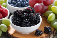 Fresh berries and grapes on a wooden table, close-up Royalty Free Stock Photography