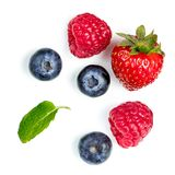 Fresh berries isolated on white background, top view. Strawberry. Raspberry, Blueberry and Mint leaf, flat lay Stock Image