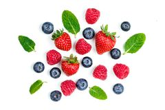 Fresh berries isolated on white background, top view. Strawberry. Raspberry, Blueberry and Mint leaf, flat lay Stock Photos