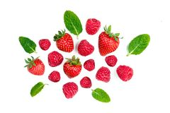 Fresh berries isolated on white background, top view. Strawberry, Raspberry  and Mint leaf, flat lay.  Royalty Free Stock Photos